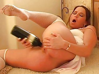 Glass dildo in wet pussy
